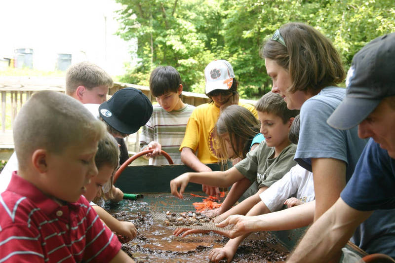 Graduate students Mary Beth Fitts and Mark Plane working with Catawba Indian children, 2007