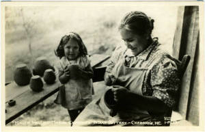 Cherokee woman and a young girl making clay pots, ca. 1930-1945.