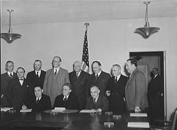 Eleven members of the War Labor Board, before their initial meeting on January 16, 1942. Frank Porter Graham seated on right